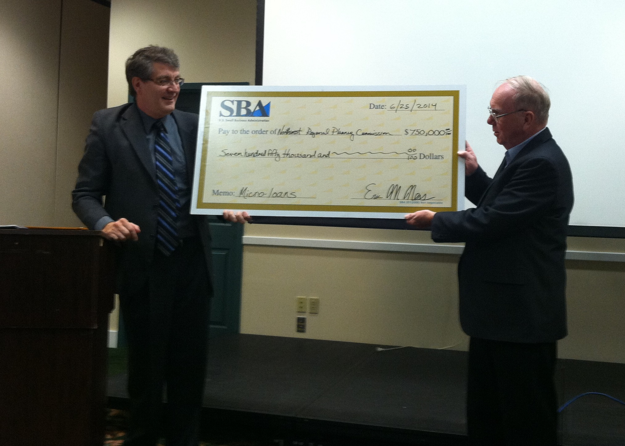 Eric Ness, the SBA's Wisconsin District Director presents check to ...